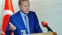 Turkey's President Recep Tayyip Erdogan speaks during a joint press conference with Somalia's President following the opening a new Turkish embassy in Mogadishu on June 3, 2016