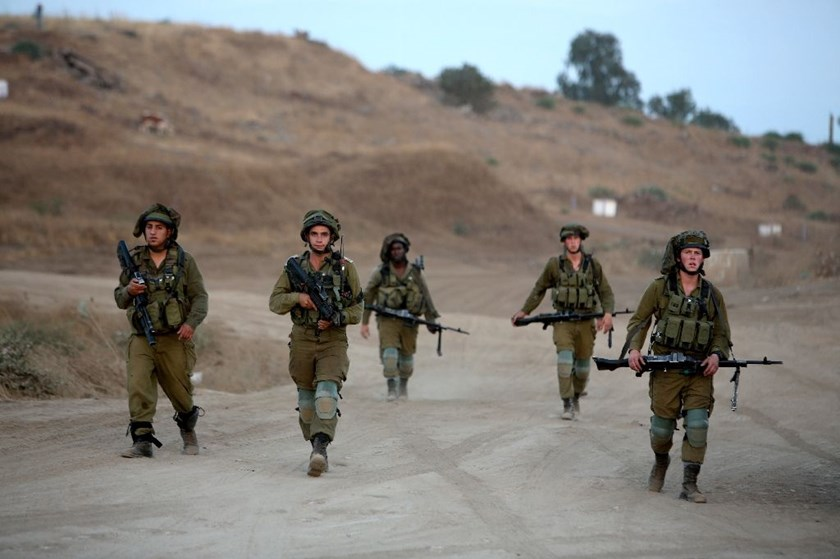 Israeli soldiers take part in a military exercise, which includes infantry, tanks and artillery units, in the northern part of the Israeli-annexed Golan Heights near the border with Syria on June 23, 2016