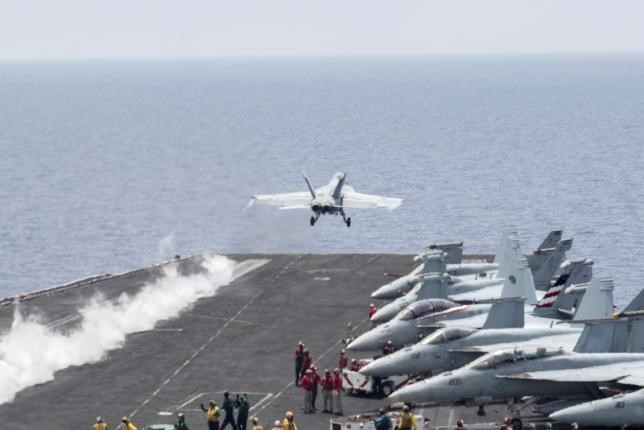 A U.S. Navy F/A-18E Super Hornet fighter jet launches from the flight deck of the aircraft carrier USS Harry S. Truman in the Mediterranean Sea in a photo released by the US Navy June 3, 2016. U.S. Navy/Mass Communication Specialist 3rd Class Bobby J Siens/Handout via REUTERS