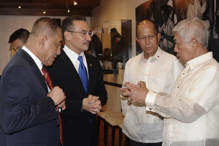 Philippine Defence Secretary Voltaire Gazmin (R) talks to Indonesian Defence Minister Ryamizard Ryacudu (L), Malaysian Defence Minister Dato Seri Hishammuddin Tun Hussein (2nd-L), and Delfin Lorenzana (2nd-R) during a trilateral meeting on border security at the Defence Ministry at military's main Camp Aguinaldo in Quezon city, Metro Manila, Philippines June 20, 2016. Armed Forces of the Philippines/Handout via REUTERS