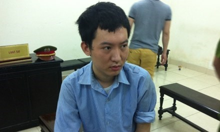 Zhang Ze Ming is tried for robbery by a court in Hanoi on Jun. 29