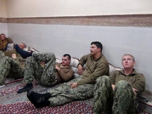An undated picture released by Iran's Revolutionary Guards website shows American sailors sit in an unknown place in Iran. sepahnews.ir/TIMA/Handout via REUTERS