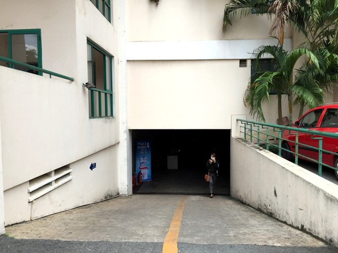 The underground parking lot entrance of the apartment building where the body of a Filipino woman was found Friday evening. Photo: Duc Tien
