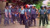Police gather after gunmen attacked the Holey Artisan restaurant and took hostages early on Saturday, in Dhaka, Bangladesh in this still frame taken from live video July 2, 2016.