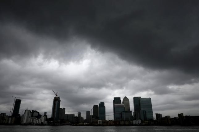 Rain clouds pass over Canary Wharf financial financial district in London, Britain July 1, 2016.