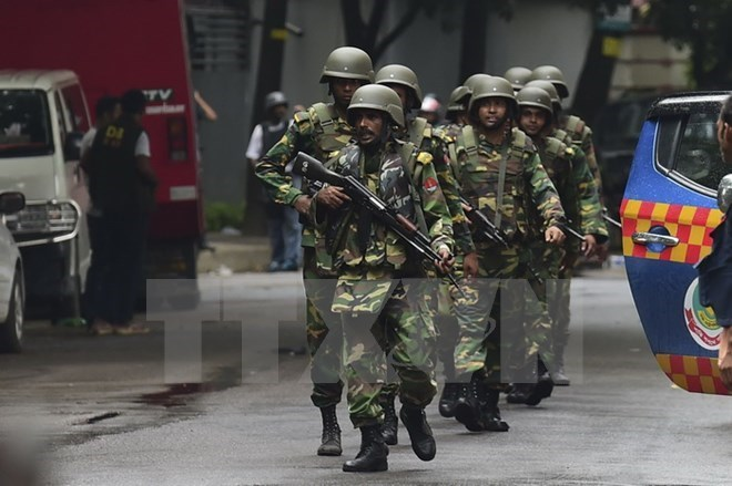 Bangladeshi soldiers patrol the scene of the attack at the Holey Artisan Bakery on July 2. Photo: AFP