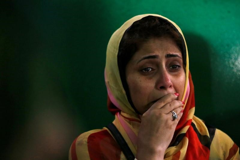 A relative cries after attending the funeral prayer of the victims who were killed in the attack on the Holey Artisan Bakery and the O'Kitchen Restaurant, in Dhaka, Bangladesh, July 4, 2016.