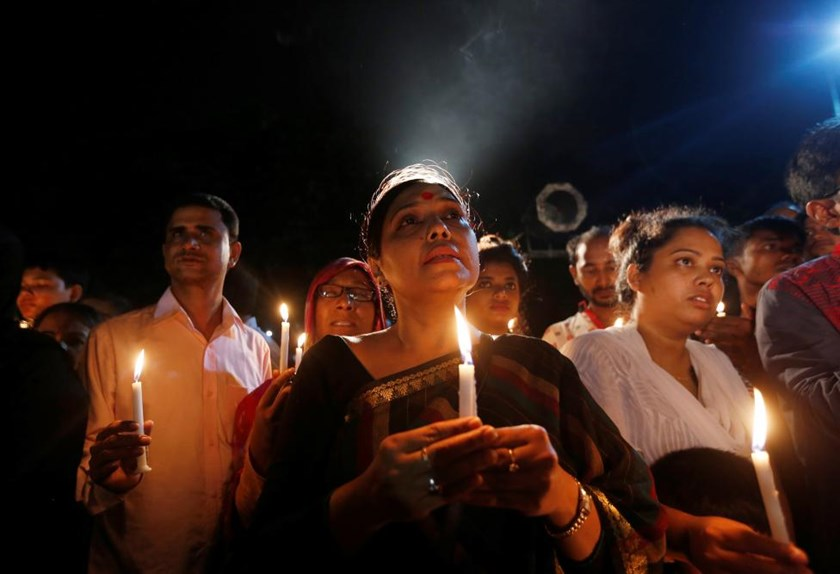 People attend a candle light vigil for the victims of the attack on the Holey Artisan Bakery and the O'Kitchen Restaurant, in Dhaka, Bangladesh, July 3, 2016