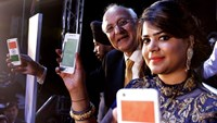 President of Ringing Bells Ashok Chadha, second from right, shows the 'Freedom 251' smartphone at an unveiling in New Delhi in February 2016. Photographer: Rajat Gupta/EPA