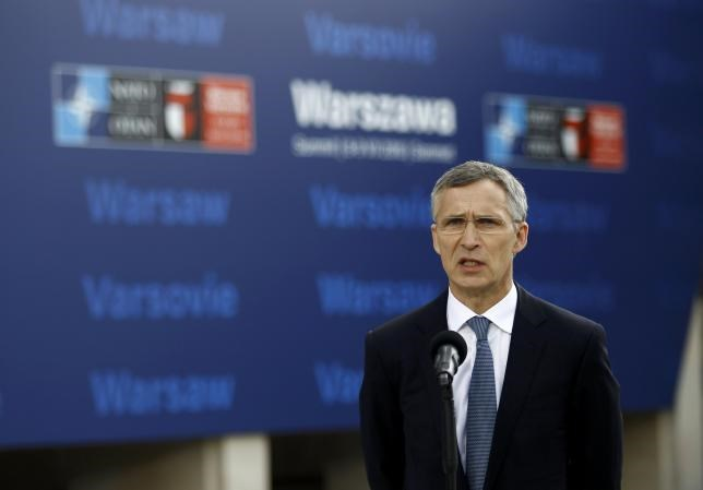 NATO Secretary-General Jens Stoltenberg speaks to the media outside PGE National Stadium, the venue of the NATO Summit, in Warsaw, Poland July 8, 2016.