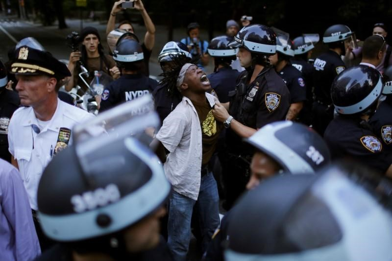 A protestor is detained by NYPD officer as people take part in a protest against the killings of Alton Sterling and Philando Castile during a march along Manhattan's streets in New York July 7, 2016.