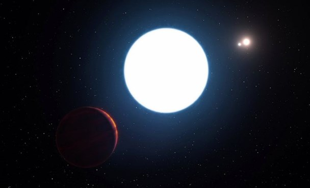 This artist's impression released by the European Southern Observatory on July 7, 2016, shows a view of the triple star system HD 131399 from close to the giant planet orbiting in the system