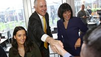 Australian Prime Minister Malcolm Turnbull (L) and Liberal candidate for the federal seat of Chisholm Julia Banks greet locals during a street walk in Oakleigh, in Melbourne's southeastern suburbs, July 8, 2016. AAP/David Crosling/via REUTERS