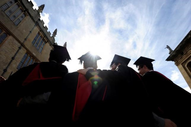 A group of graduates gather outside the Sheldonian Theatre to have their photograph taken after a graduation ceremony at Oxford University, Oxford, England, May 28, 2011.