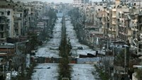 A general view shows a damaged street with sandbags used as barriers in Aleppo's Saif al-Dawla district, Syria March 6, 2015.