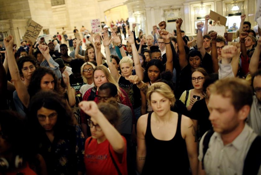 People go into Grand Central Station while they take part in a protest against the killing of Alton Sterling, Philando Castile and in support of Black Lives Matter during a march along Manhattan's streets in New York July 8, 2016.