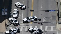 Police cars remain parked with the pavement marked by spray paint, in an aerial view of the crime scene of a shooting attack in downtown Dallas, Texas, U.S. July 8, 2016.