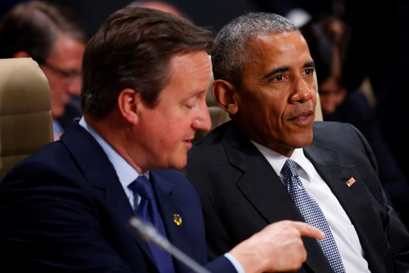 U.S. President Barack Obama and Britain's Prime Minister David Cameron participate in a working session of the North Atlantic Council at the NATO Summit in Warsaw, Poland July 9, 2016.