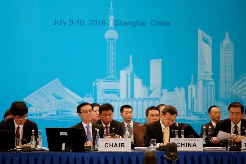 China's Commerce Minister Gao Hucheng (2nd L) attends the opening ceremony of the 2016 G20 Trade Ministers Meeting in Shanghai, China July 9, 2016.