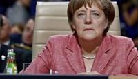 Germany's Chancellor Angela Merkel attends a working session at the NATO Summit in Warsaw, Poland July 9, 2016.