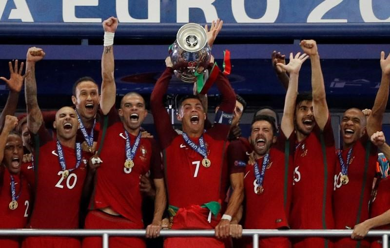 Portugal celebrates with the trophy after winning Euro 2016