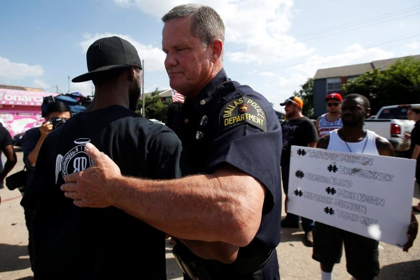 A Dallas police officer hugs a man following a prayer circle after a Black Lives Matter protest following the multiple police shootings in Dallas, Texas, U.S., July 10, 2016.