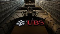 The logo of Swiss bank UBS is seen on a building in Zurich, Switzerland December 19, 2012.