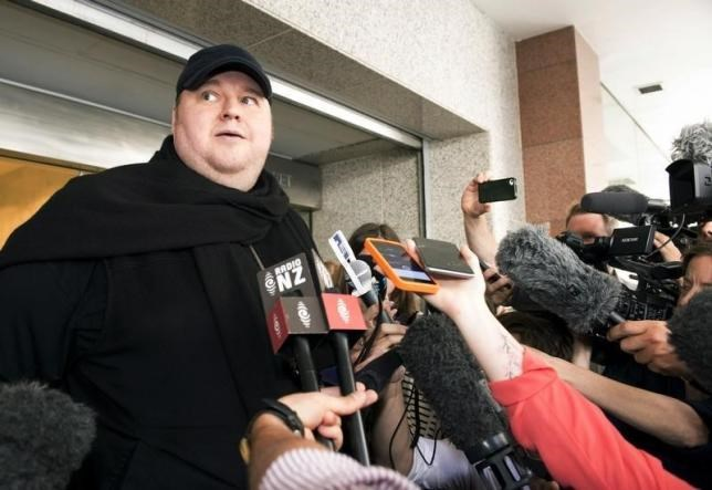 German tech entrepreneur Kim Dotcom speaks to the press after appearing in an Auckland courthouse, December 23, 2015.