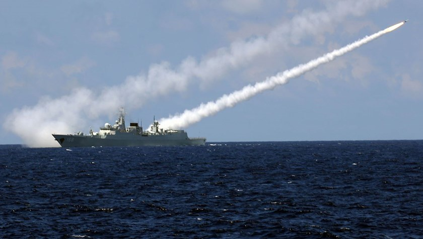Missile destroyer Guangzhou launches an air-defense missile during a military exercise in the water area near south China's Hainan Island and Xisha islands on July 8. Photographer: Xinhua News Agency/Getty Images