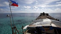 A Philippine national flag flutters in the wind aboard the BRP Sierra Madre, run aground on the disputed Second Thomas Shoal, part of the Spratly Islands, in the South China Sea March 29, 2014.
