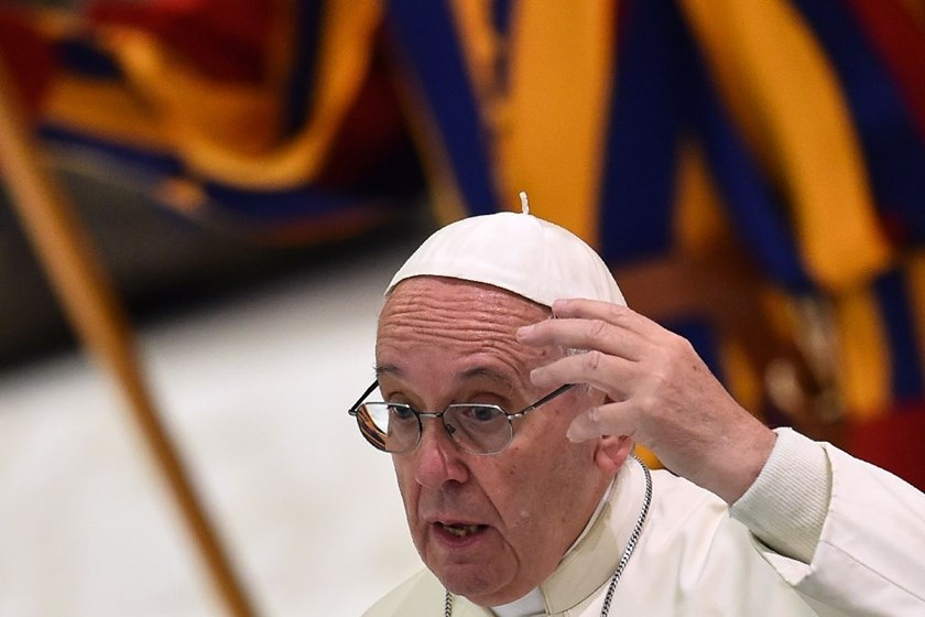 Pope Francis gestures as he speaks during a special Jubilee audience with 'vulnerable' pilgrims from the French dioceses of Lyon in the Pope Paul VI hall, at the Vatican, on July 6, 2016