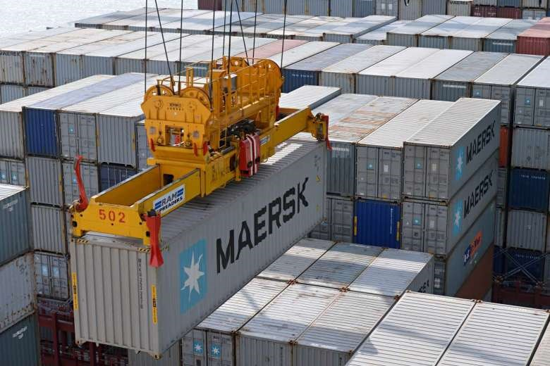 A container being moved at a port in Singapore.