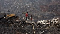 Workers drill at an open cast coal field at Dhanbad district in Jharkhand