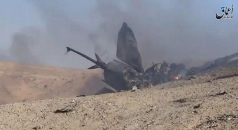 A still image taken on July 14, 2016 from a video posted on social media said to be shot today, July 14, 2016, shows the wreckage of a Syrian jet that was brought down by Islamic State fighters near the eastern city of Deir al-Zor, Syria. Social Media