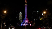 The colours of the French flag are projected on the Angel of Independence monument in Mexico City, Mexico, July 14, 2016 in tribute to the attack victims of Nice, France.
