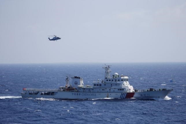 Chinese ship and helicopter are seen during a search and rescue exercise near the Hoang Sa Paracel Islands, which is claimed by Vietnam, July 14, 2016.