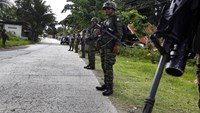 Philippine army kills 11 Muslim rebels, girl caught in a crossfire