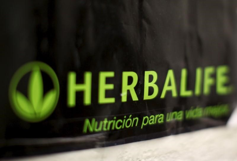 An Herbalife logo is shown on a poster at a clinic in the Mission District in San Francisco, California April 29, 2013.