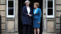 Scotland's First Minister, Nicola Sturgeon (R), greets Britain's new Prime Minister, Theresa May, as she arrives at Bute House in Edinburgh, Scotland, Britain July 15, 2016.