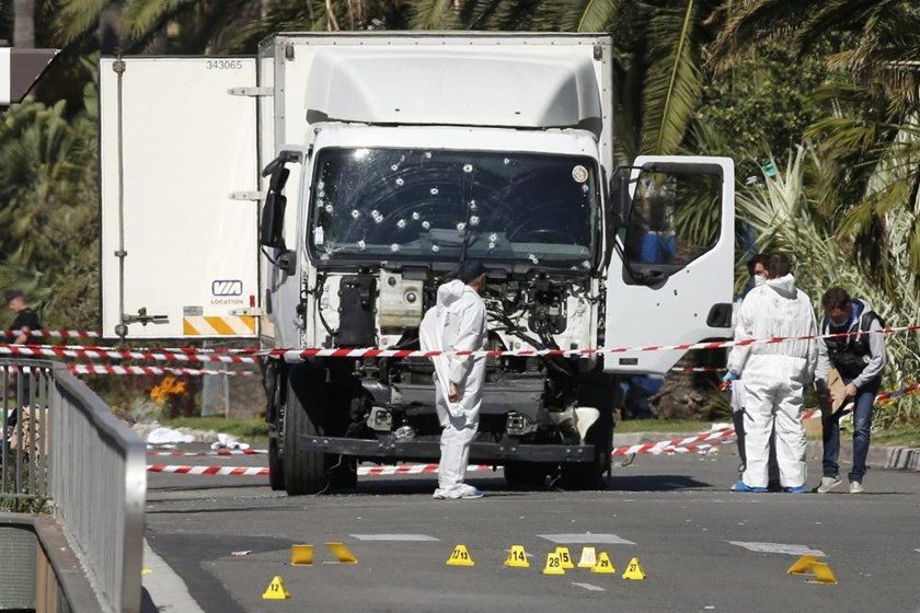 Investigators continue to work at the scene near the heavy truck that ran into a crowd at high speed killing scores who were celebrating the Bastille Day July 14 national holiday on the Promenade des Anglais in Nice, France, July 15, 2016.