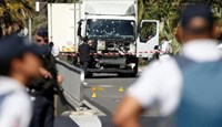French police secure the area as the investigation continues at the scene near the heavy truck that ran into a crowd at high speed killing scores who were celebrating the Bastille Day July 14 national holiday on the Promenade des Anglais in Nice, France, July 15, 2016.