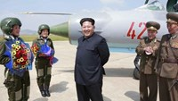 North Korean leader Kim Jong Un smiles as he attends a flight training session by female fighter pilots Jo Kum Hyang and Rim Sol in this undated photo released by North Korea's Korean Central News Agency (KCNA) on June 22, 2015.