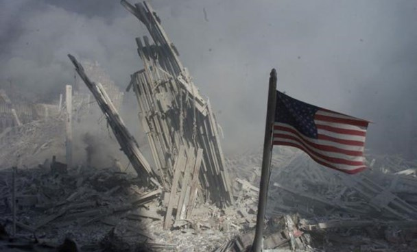 An American flag flies near the base of the destroyed World Trade Center in New York, in this file photo from September 11, 2001, taken after the collapse of the towers.