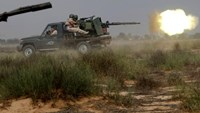 Libyan forces allied with the U.N.-backed government fire weapons during a battle with Islamic State fighters in Sirte, Libya, July 15, 2016.