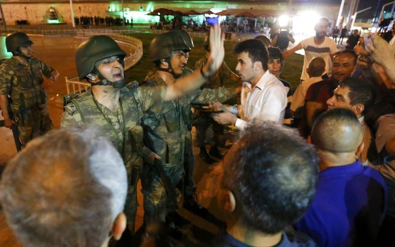 Turkish military discuss with people at the Taksim Square in Istanbul, Turkey, July 16, 2016.