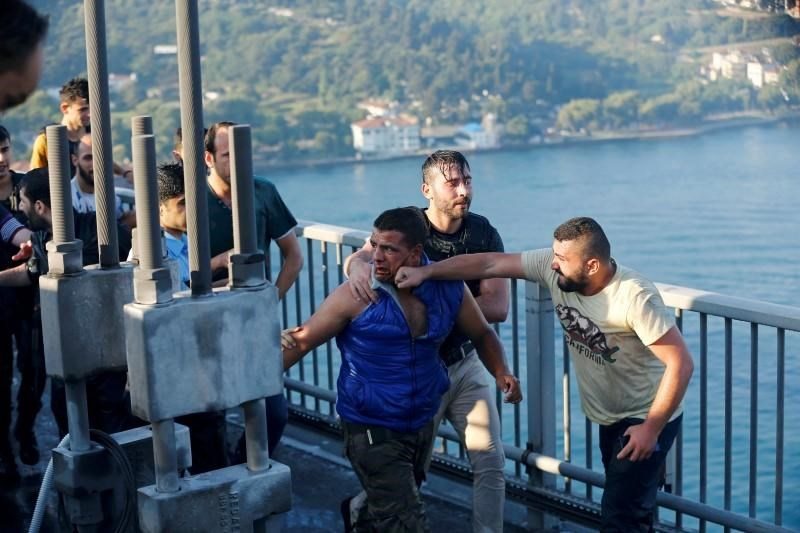 A civilian beats a soldier after troops involved in the coup surrendered on the Bosphorus Bridge in Istanbul, Turkey July 16, 2016.