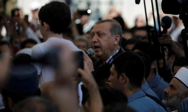 Turkish President Recep Tayyip addresses the crowd following a funeral service for victims of the thwarted coup in Istanbul at Fatih mosque in Istanbul, Turkey, July 17, 2016.