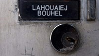 The name Mohamed Lahoualej Bouhlel is seen on a plate outside the building where he lived in Nice, France, July 17, 2016.