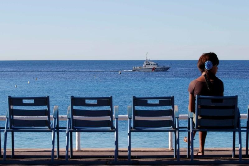 A French gendarme boat patrols waters near the beach two days after an attack by the driver of a heavy truck who ran into a crowd on Bastille Day killing scores and injuring as many on the Promenade des Anglais, in Nice, France, July 16, 2016
