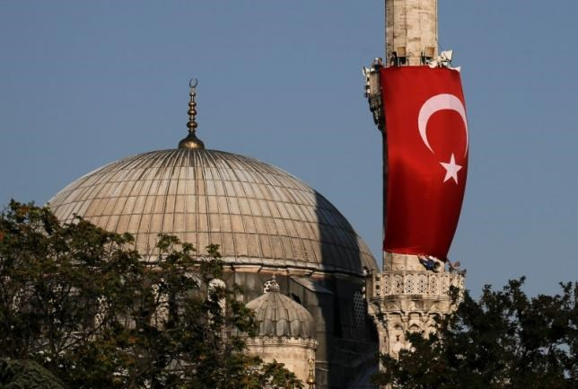 A Turkish flag is seen next to the dome of Hagia Sophia mosque in Istanbul, Turkey, July 16, 2016.